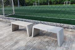 La sedia del cemento in stadio Fotografie Stock