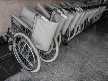 La sedia a rotelle è impilata immagine stock libera da diritti