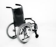 La sedia a rotelle. Immagini Stock