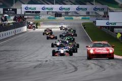 La seguridad de Ferrari lleva el comienzo del balanceo Imagen de archivo libre de regalías
