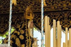 La Semana Santa Procession in Spain, Andalucia. Saint Mary figure on the float in procession during Holy Week in Easter. Seville, Andalucia, Spain Royalty Free Stock Photography