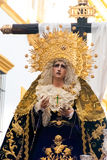 La Semana Santa Procession in Spain, Andalucia, Seville. Saint Mary figure on the float in procession during Holy Week in Easter. Seville, Andalucia, Spain Stock Images