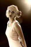 La seppia ha modificato il ritratto la tonalità della donna di retro-stile Fotografia Stock