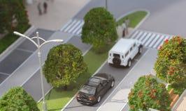 La Serbia; Belgrado; 24 marzo 2018; Modello miniatura dell'automobile di Range Rover e di Mercedes-Benz nella via; Lungomare di B Immagini Stock Libere da Diritti