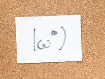 La serie de emoticons japoneses llamó Kaomoji, mirando a escondidas Imagen de archivo