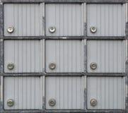 La serrure de boîte aux lettres beaucoup metal des boîtes de coffre-fort de portes image stock