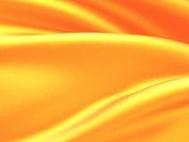 La seta dorata elegante liscia ondeggia il fondo di struttura Immagine Stock
