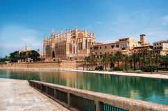 La Seu, the gothic medieval cathedral of Palma de Mallorca, Spain. Park de la Mar against La Seu, the gothic medieval cathedral of Palma de Mallorca, Spain. The Royalty Free Stock Image