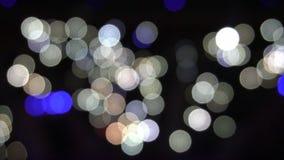 La sfuocatura astratta con il lampeggiamento del partito luminoso di Bokeh accende il fondo astratto Defocused di scintillio astr video d archivio