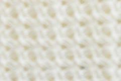 La sfuocatura tricotta il tessuto del filato per il fondo del modello Fotografie Stock
