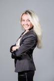 La signora sorridente weared in vestito di affari Fotografia Stock Libera da Diritti