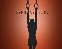 La silhouette du gymnaste sur les anneaux stationnaires Photos stock