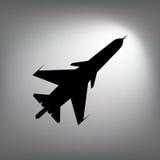 La silhouette noire d'un avion de combat Image stock