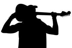 La silhouette noire d'un homme avec une guitare sur un blanc a isolé le fond Cadre horizontal Photo libre de droits