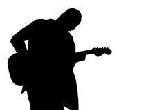 La silhouette noire d'un homme avec une guitare sur un blanc a isolé le fond Cadre horizontal Photo stock