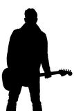 La silhouette noire d'un homme avec une guitare sur un blanc a isolé le fond Cadre vertical Images libres de droits