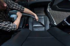 La silla del coche de la polvoreda del hombre Imagen de archivo libre de regalías