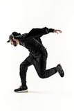 La silueta de un baile masculino del bailarín de la rotura del hip-hop en el fondo blanco Imagen de archivo