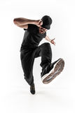 La silueta de un baile masculino del bailarín de la rotura del hip-hop en el fondo blanco Foto de archivo