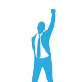 La siluetta dell'uomo di affari eccitata si tiene per mano su Fotografia Stock Libera da Diritti
