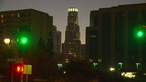 LA Skyline Day to Night Time-lapse. Day to night time-lapse view of Library Tower (US Bank building) in Los Angeles as the sun sets behind it stock video footage
