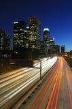 LA skyline and traffic at night Royalty Free Stock Image