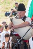 La solista dell'insieme di pifferai sul festival di folclore in Bulgaria Fotografia Stock