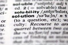 La solución de la palabra en un diccionario Foto de archivo libre de regalías