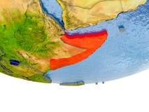 La Somalie en rouge sur le modèle de la terre Photo libre de droits