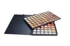 La sombra de ojos colorida compone la paleta. imagen de archivo
