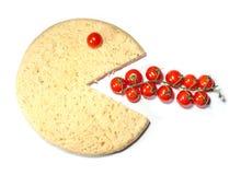 La sonrisa conceptual de la pizza come los tomates Foto de archivo