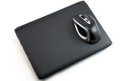 La souris sur l'ordinateur portatif Images stock