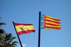 La spagna e una bandiera valenzana in un giorno di aria aperta Fotografie Stock Libere da Diritti
