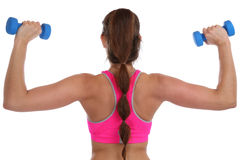 La spalla della parte posteriore di esercizio della donna di allenamento di forma fisica mette in mostra con dumbbel Fotografia Stock