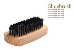 La spazzola di legno della scarpa e le setole nere con il campione mandano un sms a Immagini Stock Libere da Diritti
