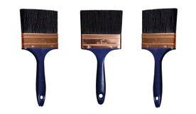 La spazzola di pittura nera isolata con il bastone blu scuro su un fondo bianco dentro differen gli angoli Fotografia Stock Libera da Diritti
