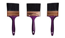 La spazzola di pittura nera isolata con il bastone porpora scuro su un fondo bianco dentro differen gli angoli Fotografie Stock