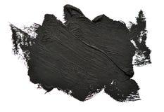 La spazzola nera segna le pitture ad olio su Libro Bianco isolato Fotografia Stock