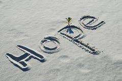 La speranza di parola scritta nella sabbia Fotografia Stock