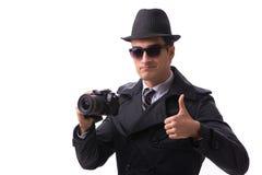 La spia con la macchina fotografica che prende le immagini isolate su bianco fotografia stock