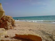 La spiaggia piena di sole Immagine Stock