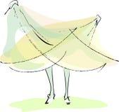 La sposa è vestito dalla holding da fare un passo Immagine Stock