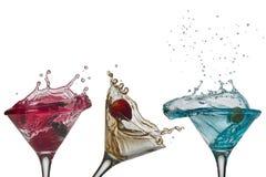 La spruzzata del cocktail libera le tazze Immagine Stock