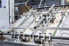 La stampa dell'industria di imballaggio allinea l'attrezzatura Q della tecnologia della fabbrica Fotografie Stock