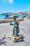 La statua bronzea in Marsaxlokk, Malta fotografie stock