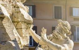 La statua del dio del Danubio nella fontana di quattro fiumi in Ro Immagine Stock Libera da Diritti