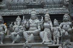 La statua delle divinità indù in Batu scava la Malesia Lumpur, India fotografia stock libera da diritti