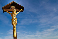La statua di Cristo crocifitto sull'incrocio Fotografia Stock