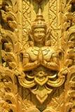 La statua dorata di angolo fotografia stock libera da diritti