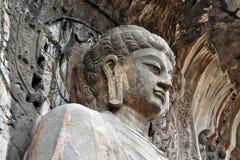 La statua principale di Buddha intorno alle grotte di Longmen sulla collina pic fotografia stock libera da diritti